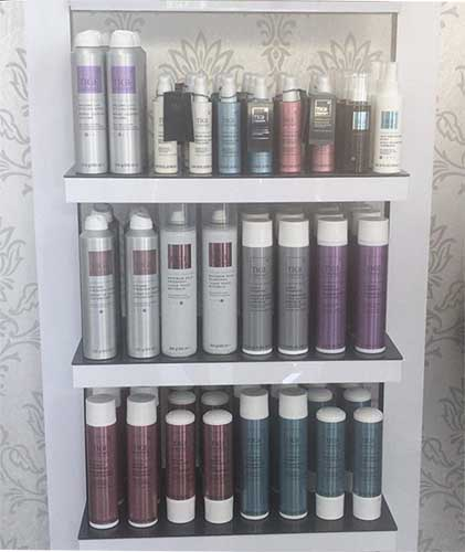 products display case with tigi hair products
