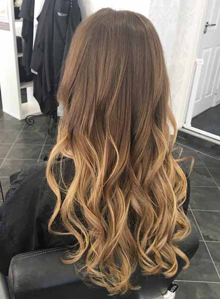 woman after hair extensions with the balayage effect